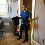 A CBI Cares volunteer helping to clean